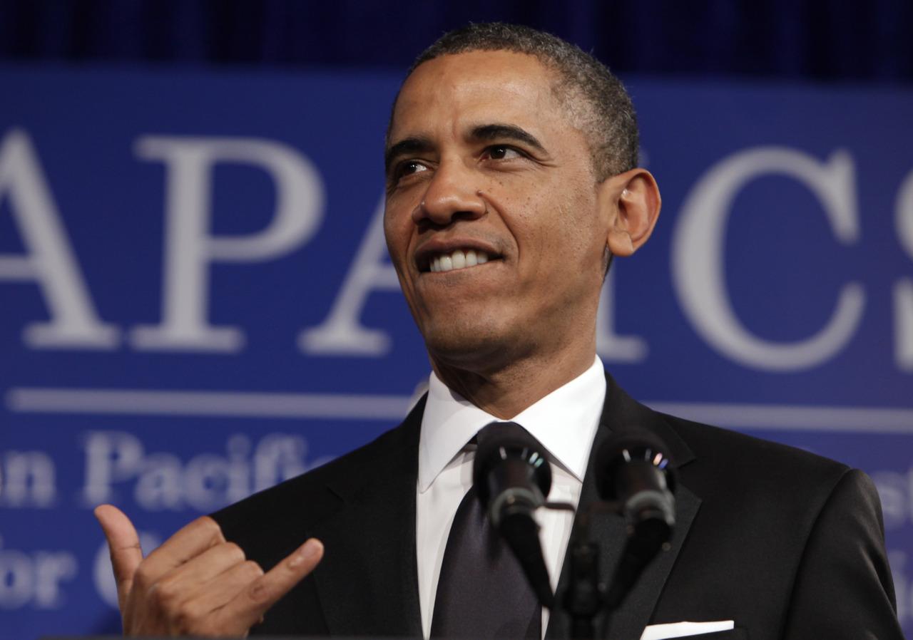 President Barack Obama gestures shaka at APAICS annual gala